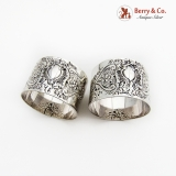 .English Repousse Floral Scroll Napkin Rings Pair Sterling Silver 1895 London