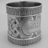 .Repousse Floral Napkin Ring Wood and Hughes Coin Silver 1880