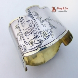 .Gold Accent Coin Silver Napkin Ring 1900